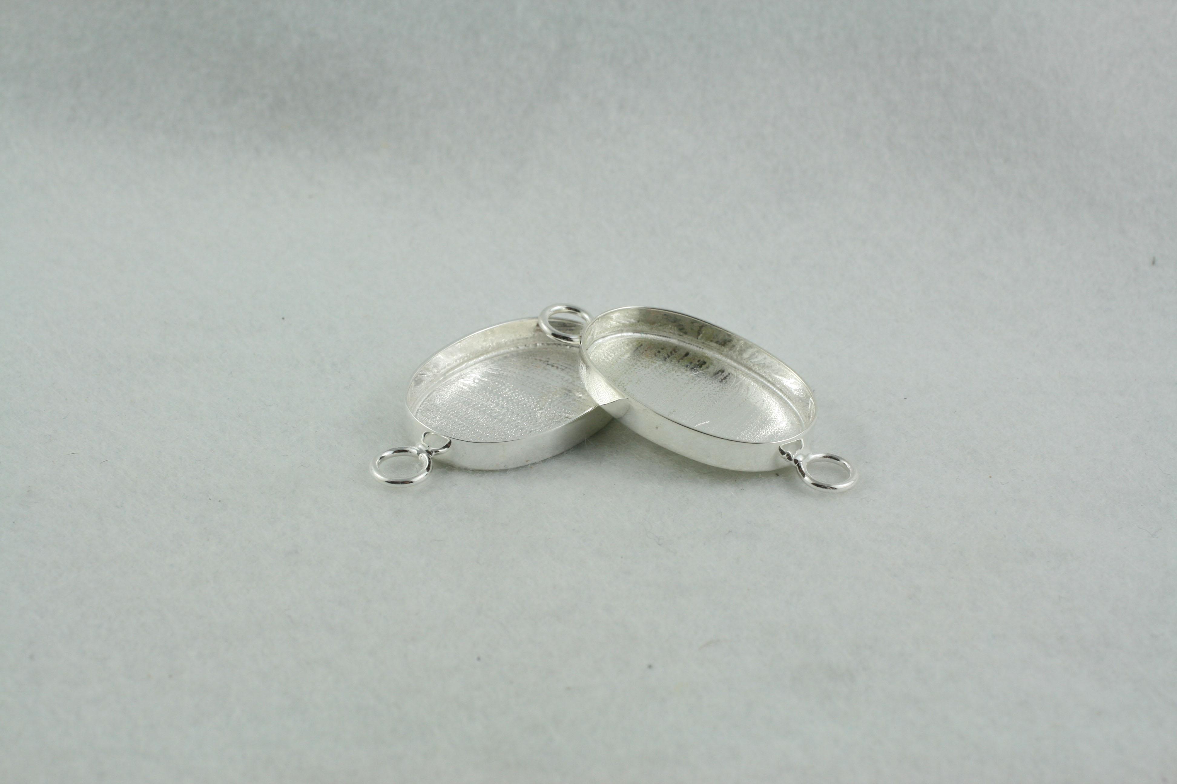 Interchangeable link oval